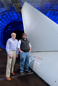 Israel Wygnanski (left), professor of aerospace and mechanical engineering, and Caltech collaborator Emilio Graff introduced and developed the active flow control system tested recently on this Boeing 757 vertical tail in the wind tunnel at NASA's Ames Research Center. (Photo courtesy of NASA Ames Research Center)