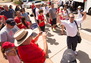 Fans surround Arizona head coach Jay Johnson as he and the team return to Tucson having earned a spot in the College World Series. (Photo courtesy of Arizona Athletics)
