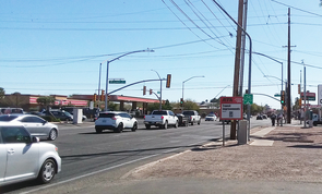 A Regional Transportation Authority sign at the intersection of First Avenue and Fort Lowell Road reminds motorists of impending construction along the north/south corridor. There is a chance that recommendations by UA graduate students will be part of the final urban design. (Photo: Stacy Pigott/UANews)