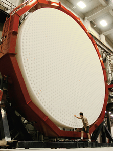The first of seven mirrors for the Giant Magellan Telescope after removal from the furnace. The back surface of the mirror is shown here during an inspection of the holes used to ventilate the mirror during operation in the telescope. (Photo: Ray Bertram/UA)