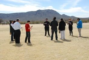 Students and mentors have been learning to use GPS devices through a series of constellation scavenger hunt activities, which were developed to feature western and American Indian understandings of science. Barron Orr of the UA Arizona Remote Sensing Center loaned iSTEM GPS units and laptop computers for the activities. Nicholas Knutson, a graduate student in the Mel and Enid Zuckerman College of Public Health and iSTEM staff, leads the activity. (Photo credit: Lillian Anderson)