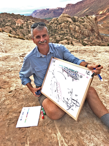 Paleofluids collaborator and structural geologist Bob Krantz reviews Paradox Basin tectonic history overlooking the Moab Fault. (Photo: Peter Reiners)