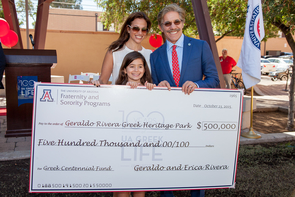 Rivera, his wife, Erica, and their daughter, Sol, with the oversize check symbolizing a $500,000 donation to build Greek Heritage Park (Photo: John de Dios/UANews)