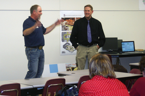 Steve Gouker and Kevin Woolridge speak about the features of the 4-H Fab Lab at the grand-opening celebration.