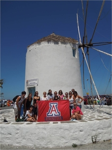 Students show their UA pride in front of a windmill at Paroikia, Paros.