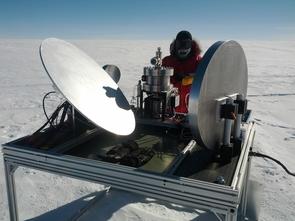 UA astronomer Craig Kulesa installs the HEAT telescope at Ridge A. The three-mirror telescope focuses light onto a small cryostat that contains detectors cooled to -370 degrees Fahrenheit. (Photo: Luke Bycroft)