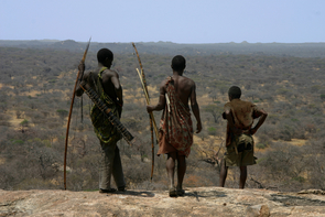 """One of the last hunter-gatherer tribes on Earth, the Hadza people of Tanzania still hunt on foot with traditional foraging methods. """"If you want to understand human hunter-gatherer movement, you have to work with a group like the Hadza,"""" said UA anthropologist David Raichlen, who led the study. (Photo by Brian Wood/Yale University)"""