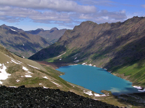 (Click to enlarge) Hallet Lake, near the crest of the Chugach Mountain Range in south-central Alaska. The abundance of algae in the lake is sensitive to summer temperature in the region. Researchers used sediment cores from Hallet Lake and others to construct a 2,000-year climate record for the Arctic. (Credit: Copyright 2006 Nicholas P. McKay)