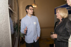 Dustin Harshman explains his work to UA President Ann Weaver Hart at a Biomedical Engineering GIDP event. (Photo: Dustin Harshman)