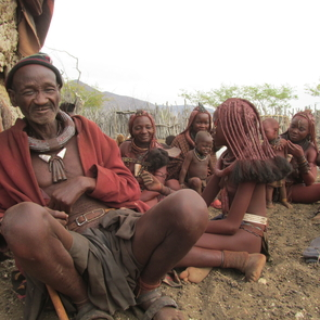 Himba chief surrounded by his wives, daughters, and sons at their village near Epupa Falls in northern Namibia. (Photo by Michaela Brumbaugh)