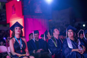 Paris Prynkiewicz, a psychology honors student from Phoenix, listens to the speakers at Commencement. (Photo: John de Dios/UANews)