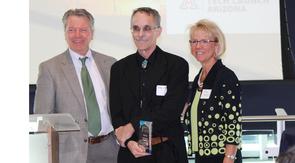 Douglas Loy (center) with David Allen, vice president of Tech Launch Arizona, and Kimberly Espy, the UA's senior vice president for research. (Photo credit: Paul Tumarkin/Tech Launch Arizona)
