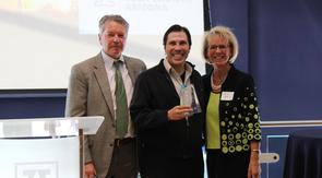 Remy Arteaga (center) accepts the award for the UA McGuire Center of Entrepreneurship, with David Allen and Kimberly Espy. (Photo credit: Paul Tumarkin/Tech Launch Arizona)