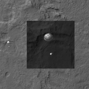 NASA's Mars Science Laboratory, Curiosity, was spotted by HiRISE as it descended to the surface on Aug. 5, 2012. Curiosity and its parachute are on the left, while above is a close-up, stretched to avoid saturation. The rover is landing on the etched plains just north of the sand dunes that fringe Aeolis Mons (informally called Mount Sharp) within Gale Crater. Details in the parachute such as the band gap at the edges and the central hole are clearly visible.