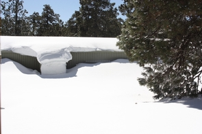 The Mt. Lemmon Sky Center covered completely in snow after a snow storm the previous night. (Photo courtesy of Jay Dee Barryman)