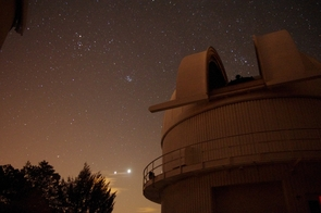 The students used the 61-inch Kuiper Telescope on Mount Lemmon to observe planets outside of our solar system. Here, the Kuiper Telescope Dome stands vigil with two planets much closer to home: Venus, the brightest object to the left of the dome, and Jupiter to the left of Venus. (Photo by Jake Turner)
