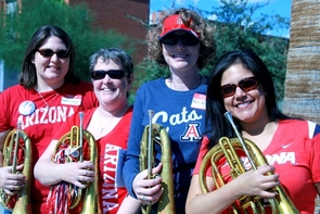 UA Alumni Band members Dawn Farmer ('02), Kathy Godwin ('96, '11), Kris Wright ('96) and Keren Cedillos ('98, '04) participated with other band members in the UA parade, which is a big draw for many attending Homecoming events.
