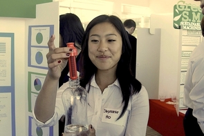 """UA pre-business major Stephanie Ho is a member of the """"Brilliant Bobble Bottles"""" team. The group, hoping to encourage reducing single-sales on water bottles, was promoting a water bottle that contains a built-in filter."""