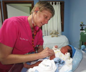 Dr. Marie Olson examines a baby at Hospitalito Atitlán.
