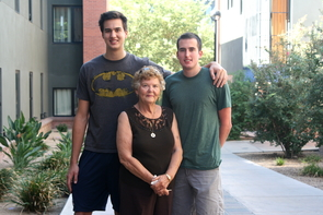 Barbara Knowles with her grandsons and UA students, Michael and Matthew Seall.