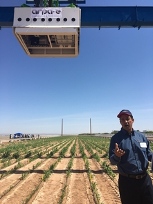 Pedro Andrade-Sanchez, precision agriculture specialist at the Maricopa Agriculture Center, discusses the operation and measurement capabilities of the scanalyzer. (Photo: Susan McGinley)