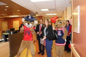 The UA team prepares to surprise Kelsey Luria. (Photo: Brittney Nicole Smith/UANews)