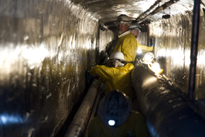 Keith Moses, foreman with FRP Construction, oversees a crew working 10-hour shifts applying QuakeWrap carbon fiber sheets in a utility tunnel just outside the Old Chemistry building on the UA campus. (Photo: Carina Johnson/UANews)