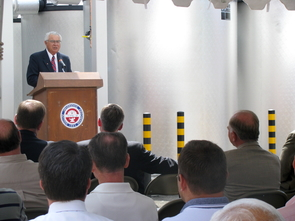 Flanked by several ice chillers, UA Senior Vice President for Business Affairs Joel D. Valdez spoke during a ceremony at the ice plant last month. Valdez said the project has captured the attention of institutions around the world.