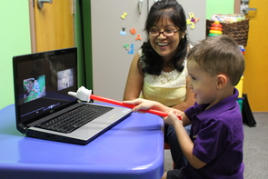 Sandoval works with a young child in the UA's Child Cognition Lab.