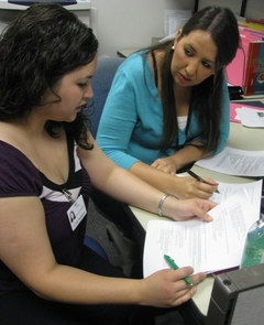 Liliana Gracia, a UA senior, spends part of her day working with UA alumna Ivonne Murrieta at Tucson Medical Center, translating English text into Spanish for the hospital's Web site and for other informative materials for patients and visitors.