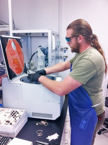 Alex Laetsch, research specialist and compound manager at work in the lab.