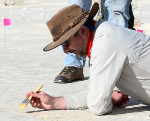 Professor Matthew Bennett, the research team leader, excavating a footprint at the White Sands National Monument field site. (Photo: David Bustos/National Park Service)