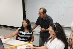 """Jaime Fatás-Cabeza (center), a federally certified interpreter with extensive experience in court and medical translation and interpretation, was specifically recruited by Roseann Dueñas-Gonzalez, who directs the UA's National Center for Interpretation, Testing, Research and Policy. """"We have worked together all of these years to grow the program and support the development of students,"""" she said. (Photo credit: Alejandro Gonzalez)"""