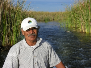 Juan Butron is a leader of the Mexican community Ejido Johnson that is adjacent to the ciénega. Here he is leading a boat tour of the ciénega. A superb naturalist, he knows the ciénega  better than anyone and was instrumental in developing the community's ecotourism business. (Photo credit: Francisco Zamora/Sonoran Institute)