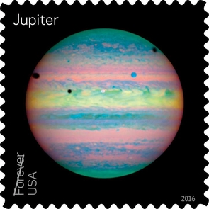 NASA's Hubble Space Telescope has obtained many beautiful images of Jupiter, including the unusual one that is featured on the stamp pane. Hubble's Near Infrared Camera and Multi-Object Spectrometer captured this view in 2004 during a rare alignment of three of the planet's moons: Io, Ganymede, and Callisto. (Image: NASA/ESA/Erich Karkoschka)