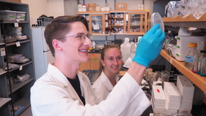 "Kyle Kline (left), a 2017 KEYS alumnus, worked in the lab of Betsy Arnold (right). Kline, who will be a UA freshman this fall, said, ""KEYS took science beyond the textbook. During my time at the UA, I was able to sample the life of a researcher and begin to understand the demanding work environment of a professional research laboratory. And, for the first time in my life, I was able to conduct experiments that didn't have a predetermined answer."" (Photo: Robert Meares)"