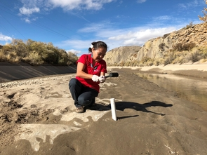 Karletta Chief taking a sediment core along the banks of the San Juan River. (Photo: Emily Driscoll/Science Friday)