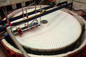 Steward Observatory Mirror Lab workers installed 1,160 ceramic cores in the mirror mold that was made for casting the primary and tertiary mirrors as a single piece of glass for the LSST.