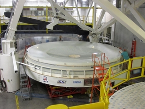 Measuring 27 feet in diameter, the LSST mirror rests on the polishing table in the UA's Richard F. Caris Mirror Lab. It's the only mirror in the world that combines a large primary mirror and a smaller tertiary mirror in one piece. (Photo: Mirror Lab/LSST Corp.)