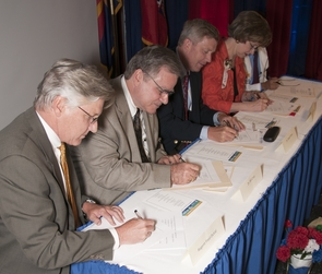 DuVal, Crist, Flynn, Bayless, (Chundu is hidden at the end of the table) sign the affiliation agreement between the UA, Maricopa Integrated Health System and District Medical Group.