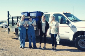 At the farm, Madeline Ryder, Taryn Contento, Lisa VanWagenen and Erin Smith stand in front of the stake truck they use to collect food waste from Tucson restaurants. (Photo: Braelyn Jane Smith)