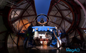 The Magellan Telescope with the MagAO's Adaptive Secondary Mirror mounted at the top looking down some 30 feet onto the 21-foot diameter primary mirror, which is encased inside the blue mirror cell. (Photo: Yuri Beletsky, Las Campanas Observatory)