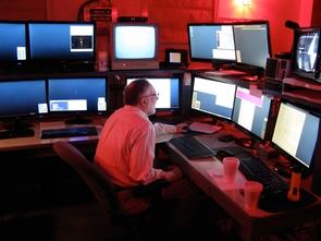 (Click image to enlarge) McMillan in the SPACEWATCH control room on Kitt Peak. (Photo: Ron Mastaler/Arizona Radio Observatory)