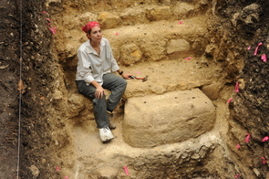 UA graduate student Melissa Burham works at a stone monument placed just before the Preclassic collapse in the second century. (Photo: Takeshi Inomata)