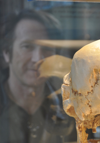 Michael Hammer with an ancient hominid fossil.
