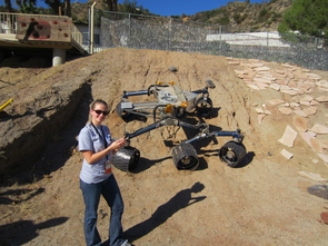 """During one of her stints at NASA's Jet Propulsion Laboratory, Shaunna Morrison got to play with the """"scarecrow,"""" a replica of the Curiosity rover. The scarecrow lacks the instrumentation of Curiosity, but features identical wheels and base, and is exactly weighted and calibrated so it behaves as it would on Mars. """"We can control it with a smartphone, and it was pretty neat to tell it to spin its wheels this way and move backwards and things like that."""" (Photo: Thomas Bristow/NASA)"""