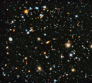 Hubble's Ultra-Deep Field image (full range of ultraviolet to near-infrared light) – made from 841 orbits of telescope viewing time – contains approximately 10,000 galaxies, including some of the most distant galaxies to have been imaged by an optical telescope, and extending back in time to within a few hundred million years of the Big Bang. (Image: NASA, ESA, H. Teplitz and M. Rafelski/IPAC/Caltech, A. Koekemoer/STScI, R. Windhorst/Arizona State University, and Z. Levay/STScI)