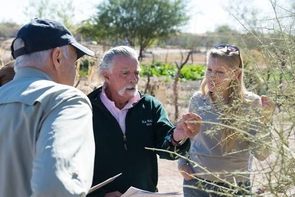 At the Tucson Mission Gardens, Nature's Notebook observers Jim Love (left) and Hank Verbais (center) learn to appreciate changes in the plants they observe, such as young leaves on the palo verde tree. Erin Posthumus (right), outreach coordinator with the National Phenology Network, assists. (Photo credit: Brian F. Powell)