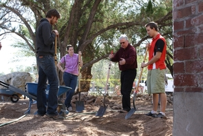 UA planner Grant McCormick works with students on their project to help stabilize the foundation of Old Main.