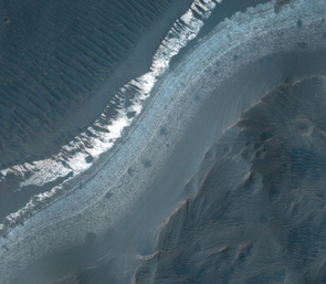 The HiRISE camera on the Mars Reconnaissance Orbiter took this image of the largest fan in Holden crater when the orbiter was flying about 162 miles over the surface in March 2007. Geologists discovered a complex geologic history for the site, including two wet episodes that may have been amenable to life.